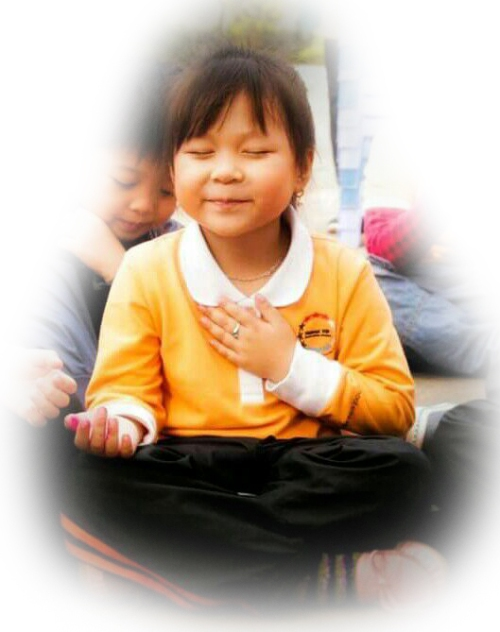 happy-meditating-oriental-child